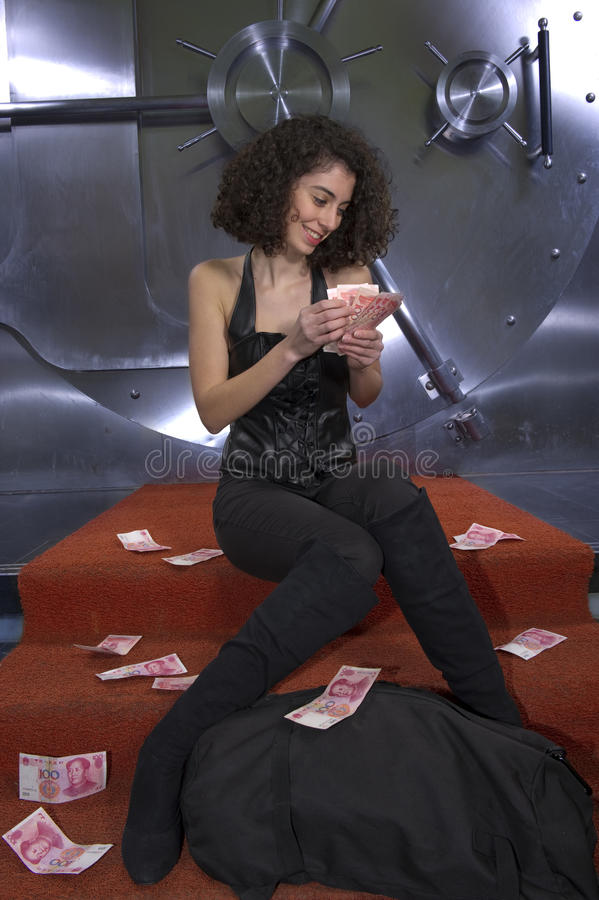 Female Criminal Sitting On The Stairs Counting Royalty Free Stock Photography