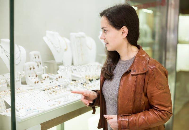 Female customer admiring jewellery stock images