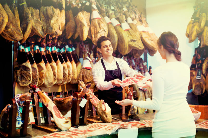 Female customer buying Spanish jamon royalty free stock images