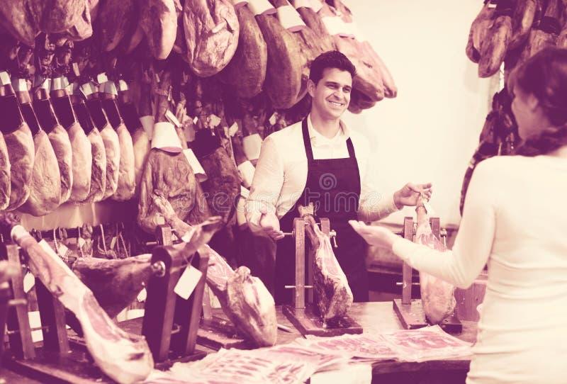 Female customer buying Spanish jamon stock photography