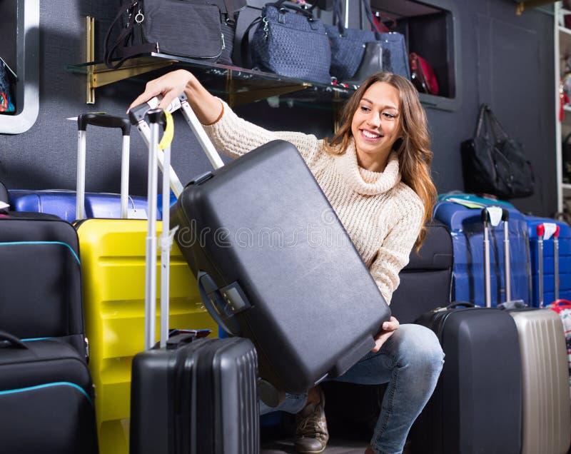 Download Female Customer Choosing Travel Suitcase Stock Image - Image of display, people: 83702145