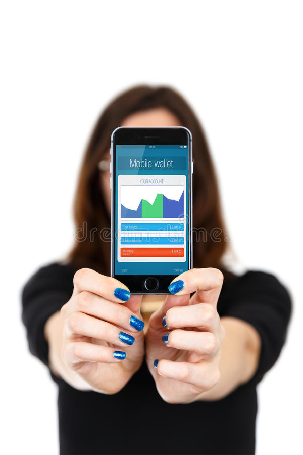 Female customer paying for purchase with mobile phone. (smartphone royalty free stock photography