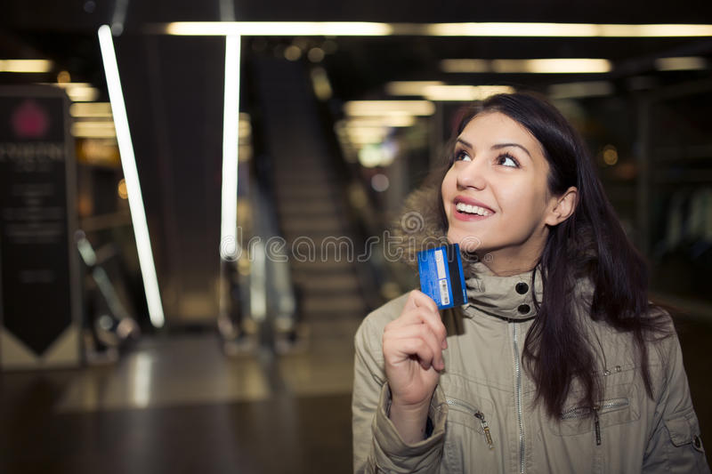 Female customer with plastic card shopping in the mall.Young teen woman using parents credit card for shopping in the mall,wanderi royalty free stock photo