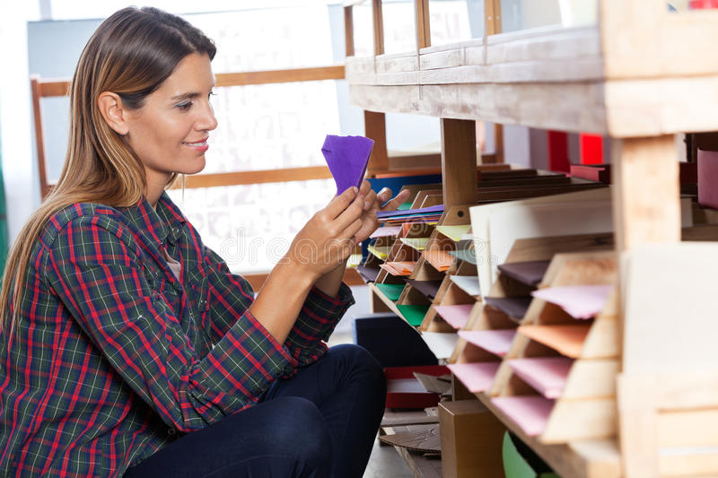 Female Customer Selecting Envelop From Shelf stock photos