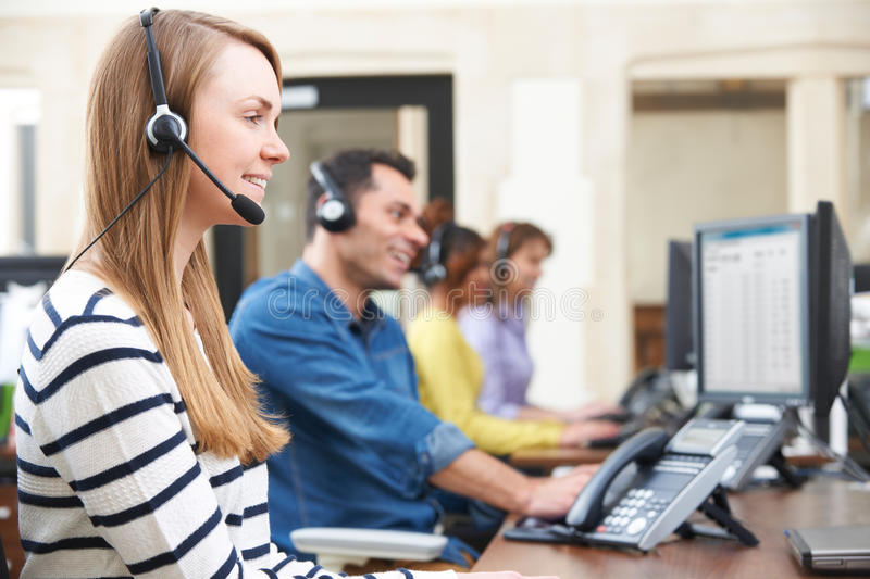 Female Customer Services Agent In Call Centre. Customer Services Agents In Call Centre stock photography