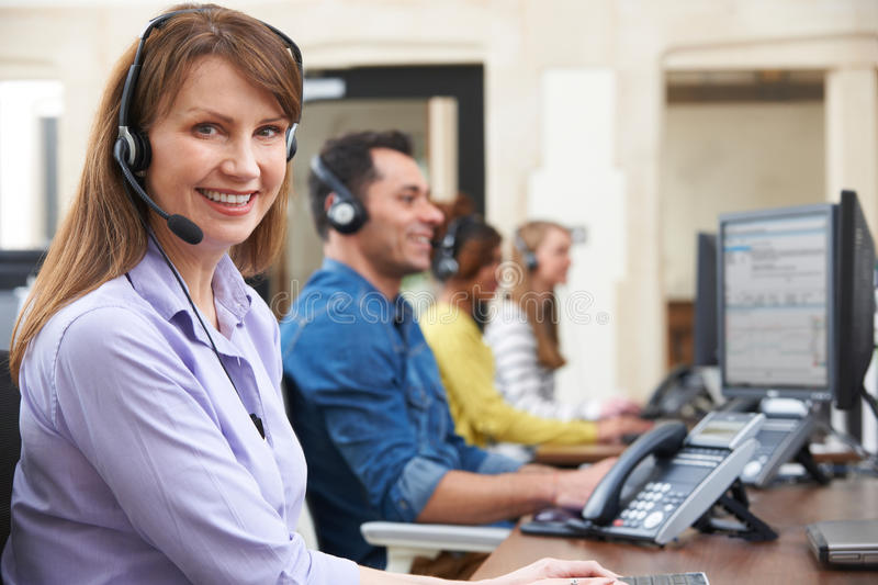 Female Customer Services Agent In Call Centre. Customer Services Agents In Call Centre stock photos