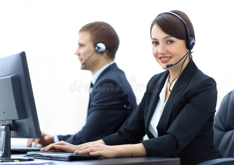 Female Customer Services Agent With Headset Working In A Call Center. Positive Female Customer Services Agent With Headset Working In A Call Center stock photo