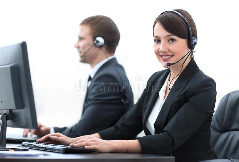 Female Customer Services Agent With Headset Working In A Call Center royalty free stock image