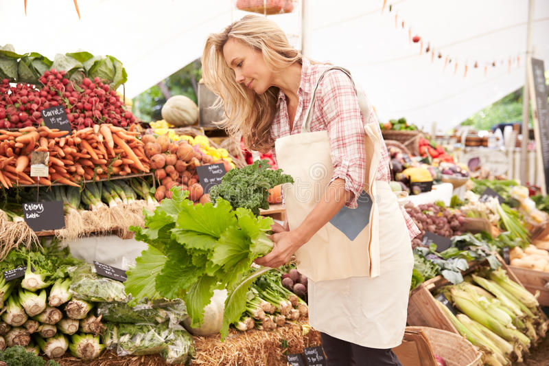 Female Customer Shopping At Farmers Market Stall royalty free stock images