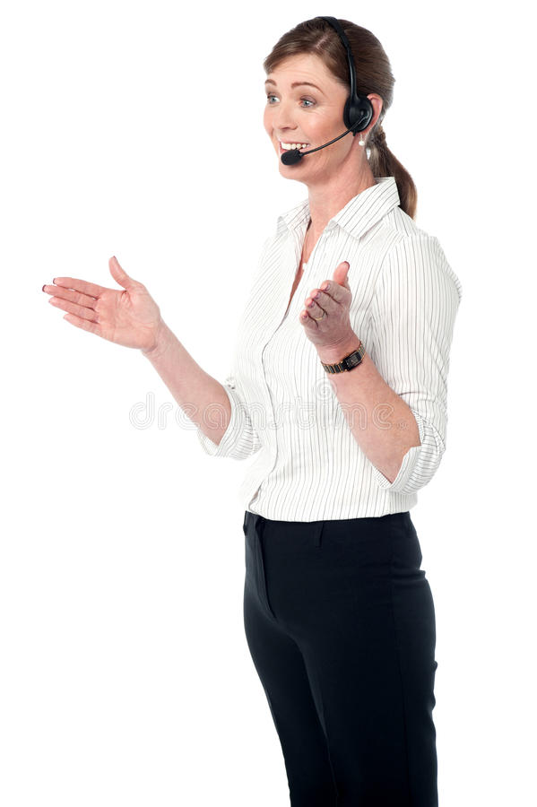 Female customer support executive. Customer support staff assisting client over a call royalty free stock photography