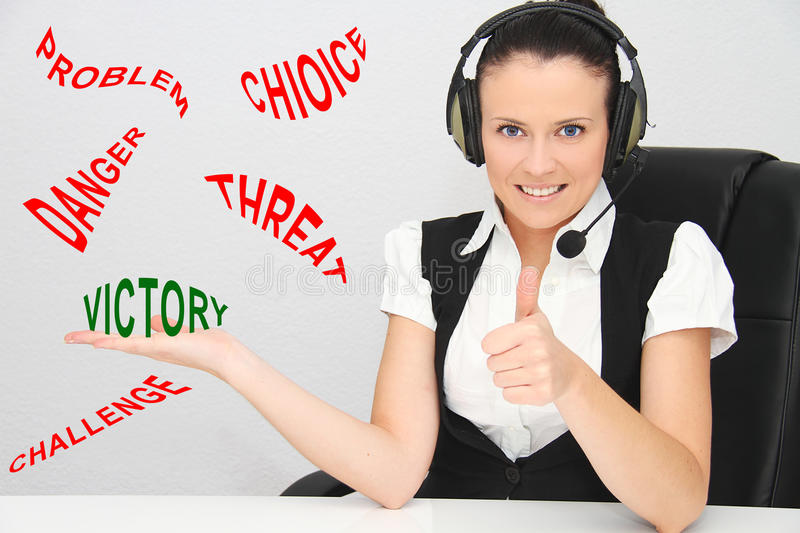 Female customer support operator with headset. Photo of the Female customer support operator with headset stock photo