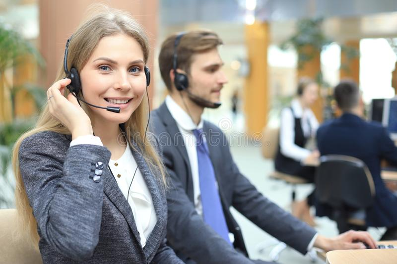 Female customer support operator with headset and smiling royalty free stock photo