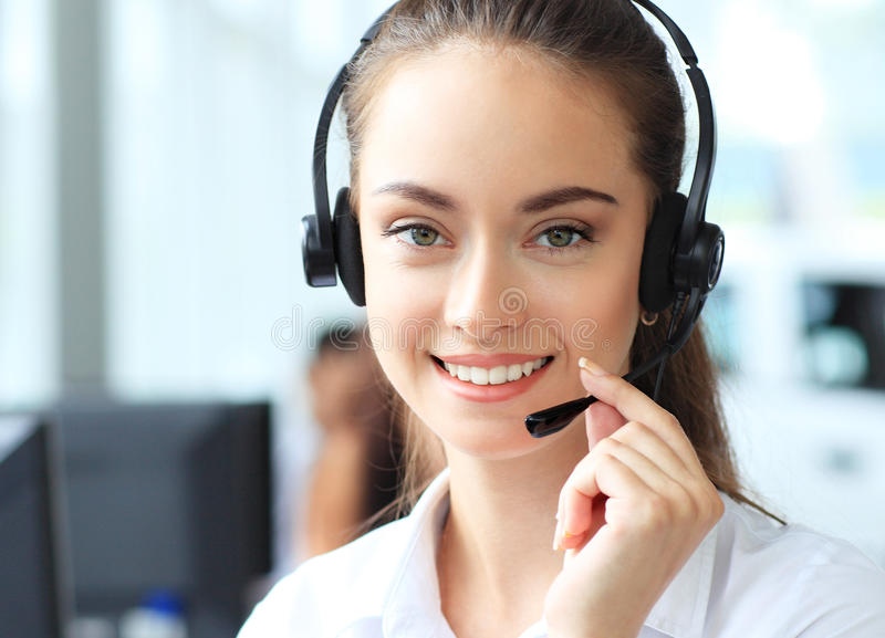 Female customer support operator with headset. And smiling stock images