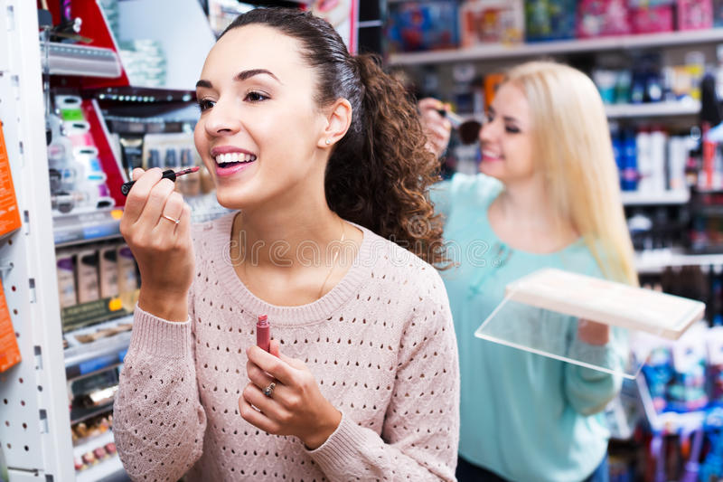 Female customers at cosmetic shop stock photos