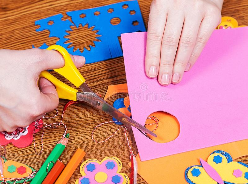 Female that cut paper shapes for children royalty free stock images