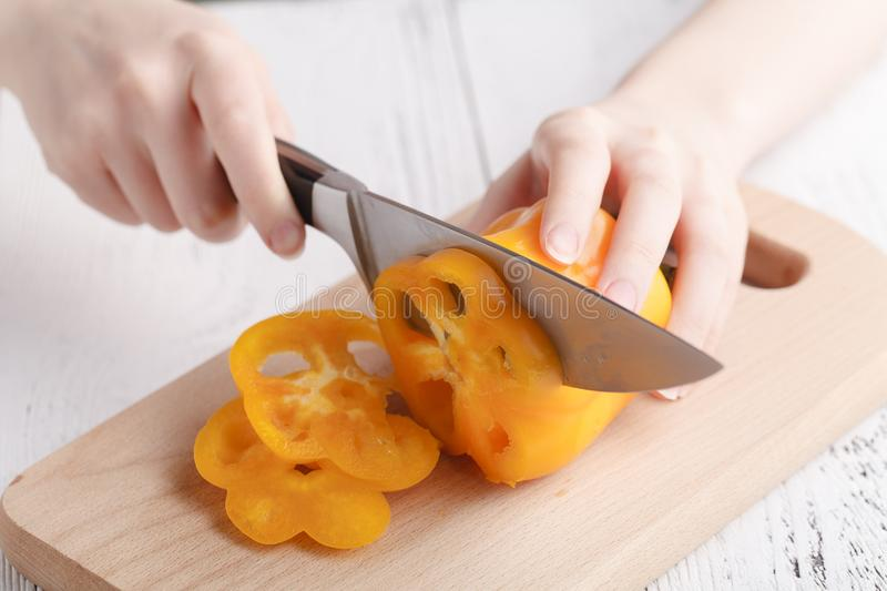 Female cutting sweet bulgarian pepper royalty free stock photo