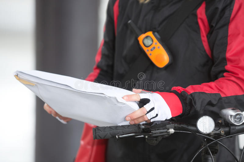 Female Cyclist Holding Courier Package stock photos