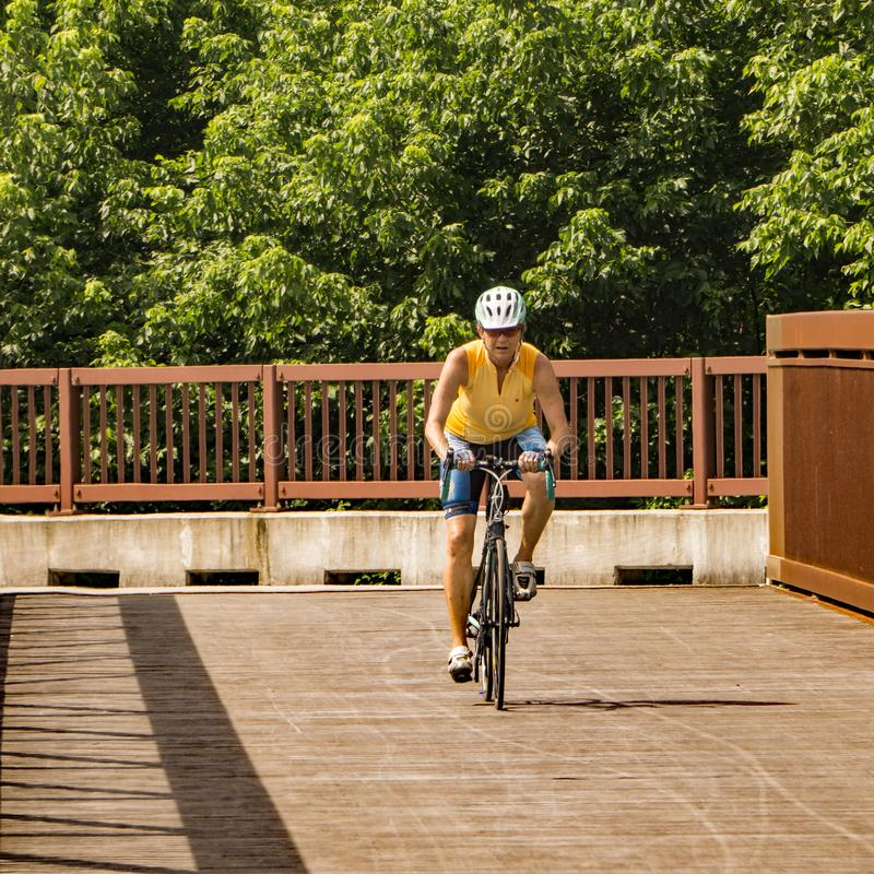 Female Cyclist on a Roanoke River Greenway royalty free stock photo