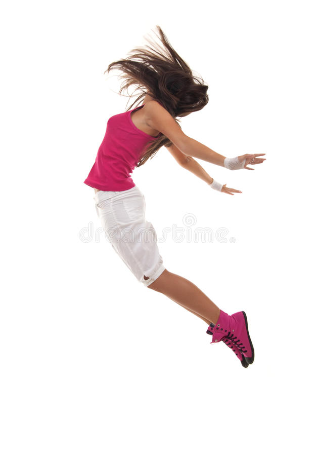 Female dancer jumping. On a white background stock image