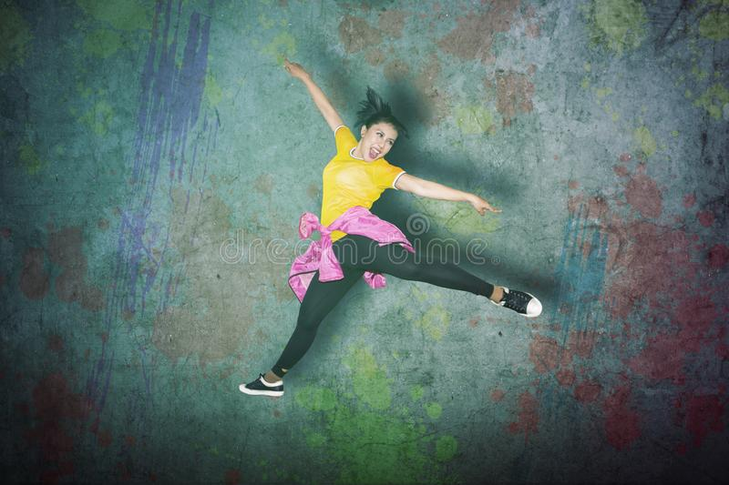 Female dancer jumping high in the studio stock photography