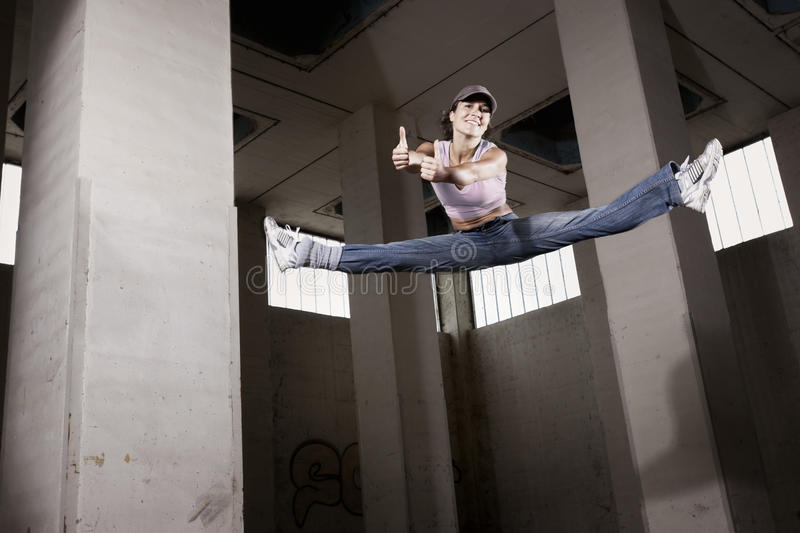 Download Female Dancer Jumping With Thumbs Up. Stock Photo - Image: 19995172