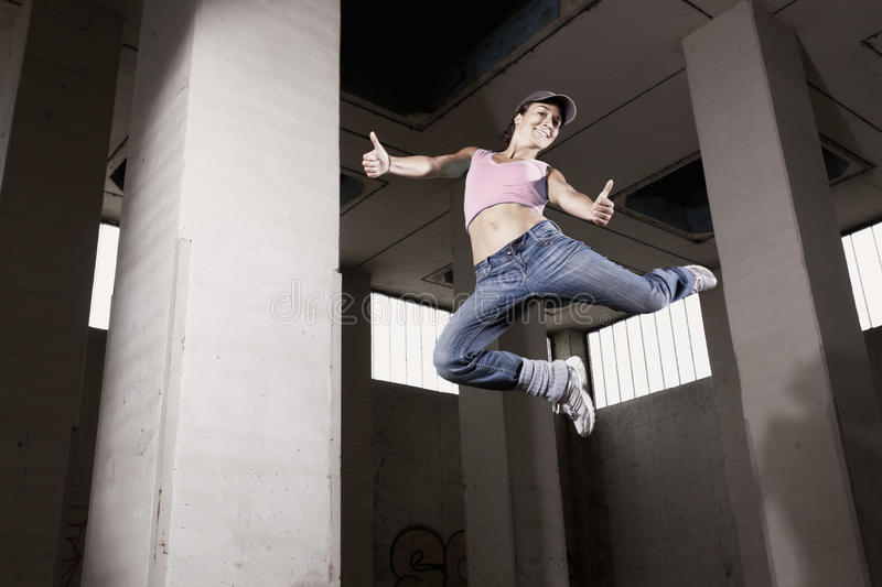 Download Female Dancer Jumping With Thumbs Up. Stock Image - Image: 19995205
