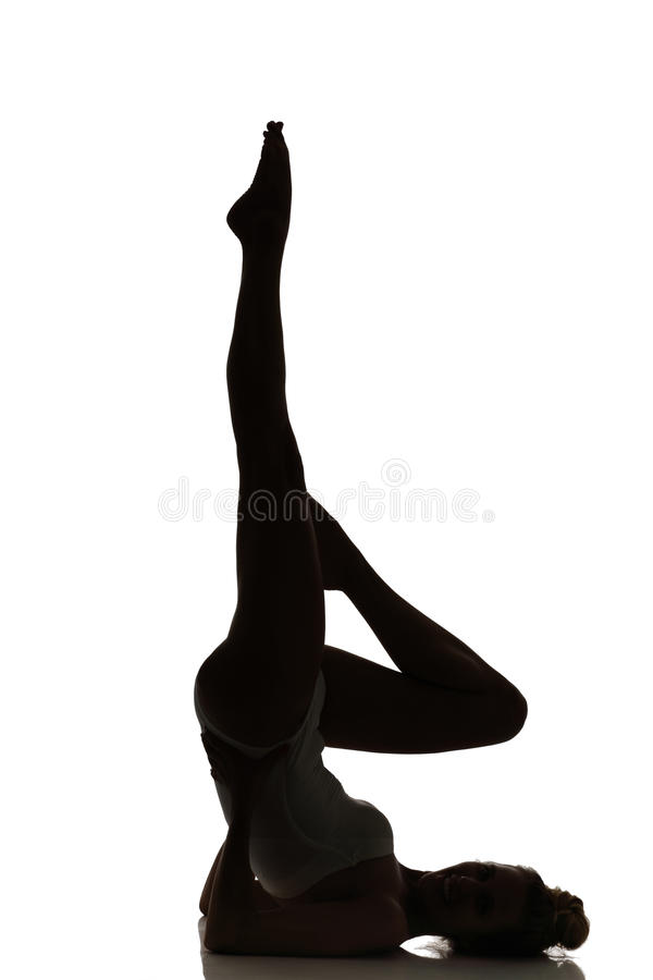 Female Dancer posing silhouette studio shot. On white royalty free stock photography