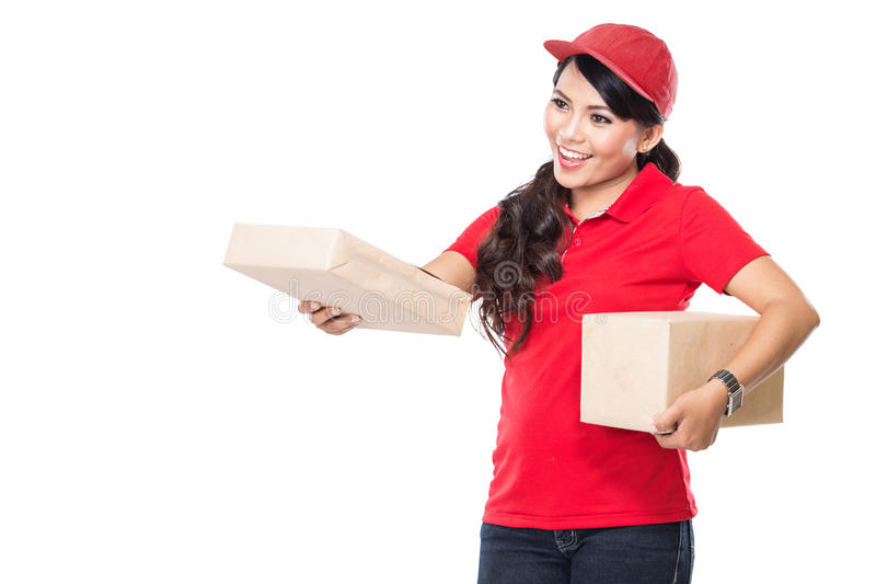 Female delivery service happily delivering package to costumer royalty free stock photography
