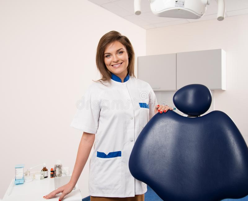 Female dentist at dentist's surgery royalty free stock image
