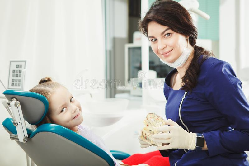 Female dentist doctor and little patient at office royalty free stock photo
