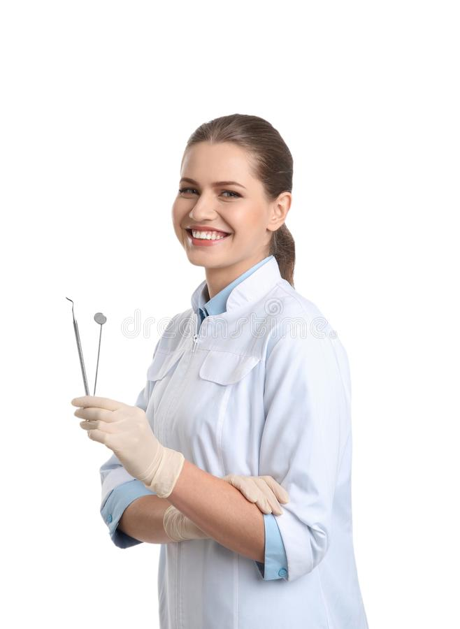 Female dentist holding professional tools on white. Background royalty free stock image