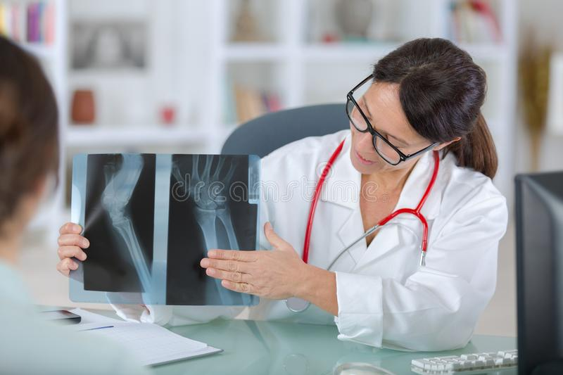 Female dentist showing x-rays to patient royalty free stock photo