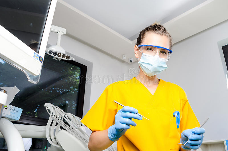 Female Dentist With Tools stock photo