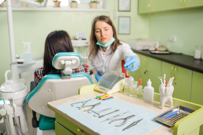 Download Female Dentist Working At Dental Clinic With Patien Stock Image