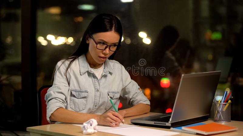 Female designer drawing sketches looking laptop, educational online lesson royalty free stock photo