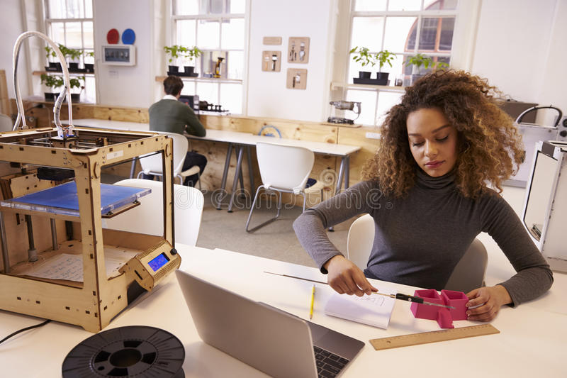Female Designer Measuring Model In 3D Design Studio royalty free stock image