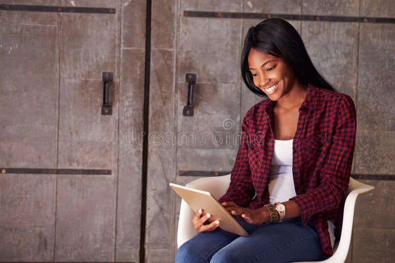 Female Designer In Modern Office Working On Digital Tablet stock photos