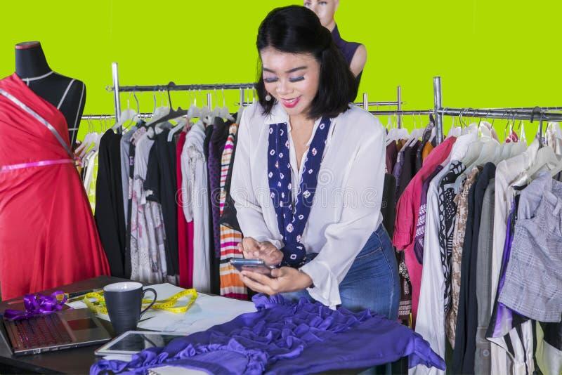 Female designer taking photo of her new dress royalty free stock photos