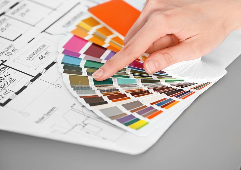 Female designer working with color palette samples. At table royalty free stock photography