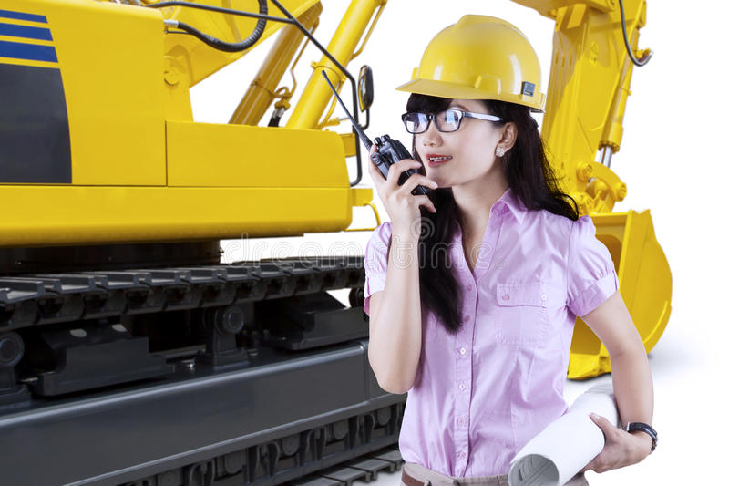 Female developer with excavator royalty free stock photo