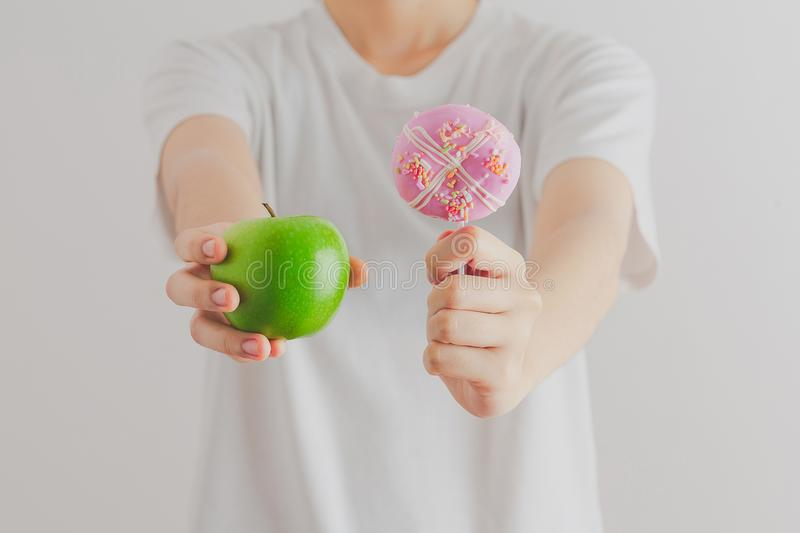Female on dieting for good health concept. Young woman holding D stock photo