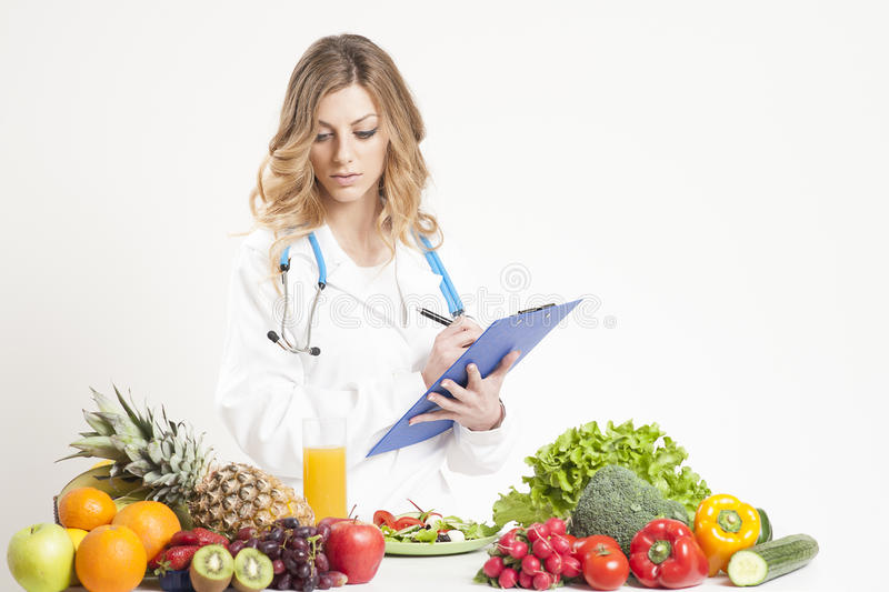 Female dietitian. In uniform with stethoscope stock photos