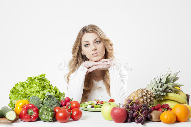 Female dietitian. In a white background royalty free stock photos