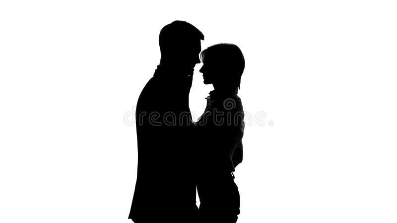Female director shadow tenderly kissing her subordinate employee, office romance. Stock photo stock photos