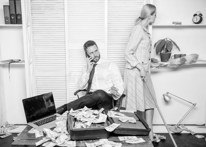 Female discrimination at workplace. Discrimination concept. Woman cleaning up office while boss counting money. Equal stock photos