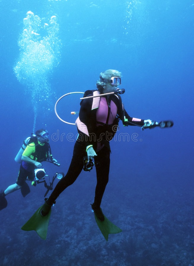 Female Diver Surfacing stock photo