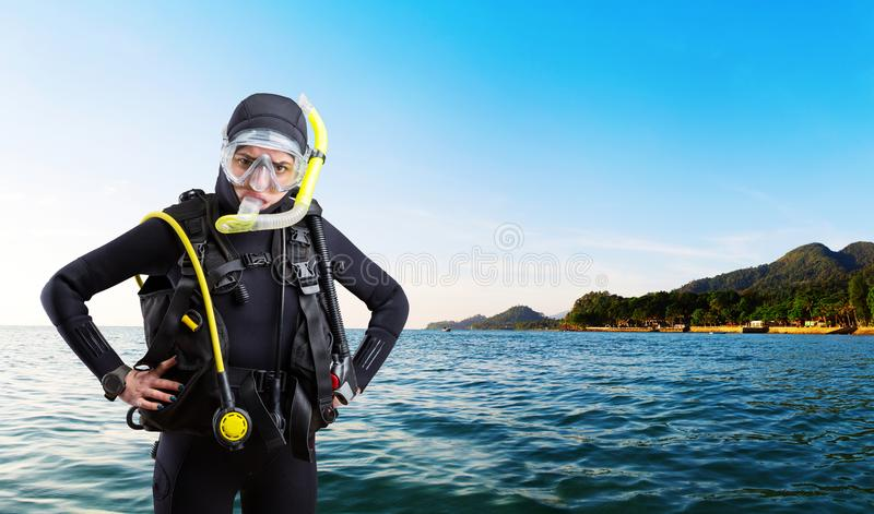 Female diver sportsman in wetsuit and diving gear royalty free stock image