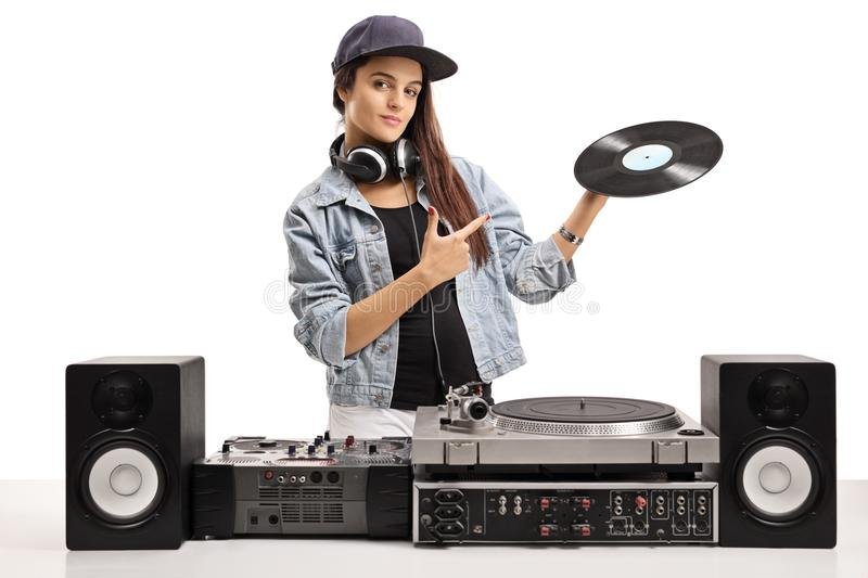 Female DJ holding a vinyl record and pointing. Isolated on white background royalty free stock images