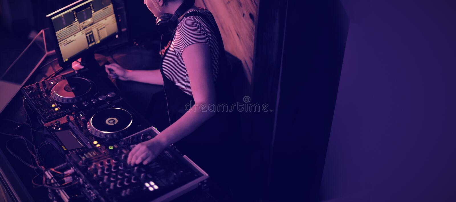 Female dj mixing music in bar stock photos