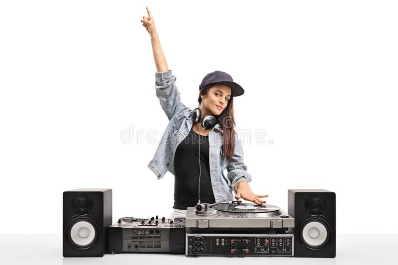 Female DJ playing music on a turntable. Isolated on white background royalty free stock photography